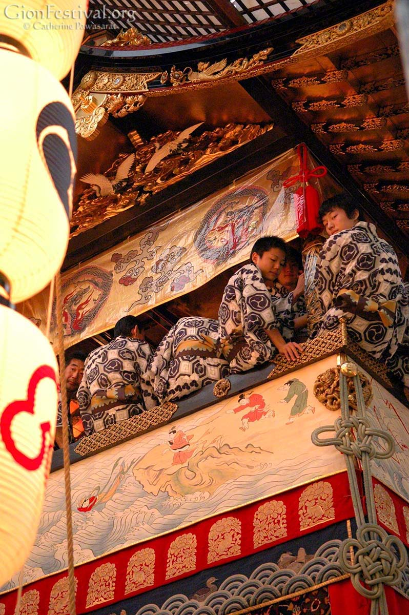 hoka boko musicians on float night lanterns gion festival kyoto japan