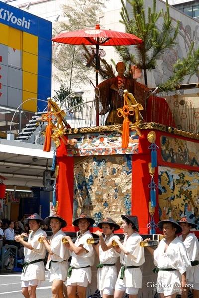 tokusa yama deity statue textiles men gion festival procession kyoto japan
